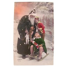 Tinted French Real Photo Postcard, Santa, Children, Dolls and Toys, Circa 1920s