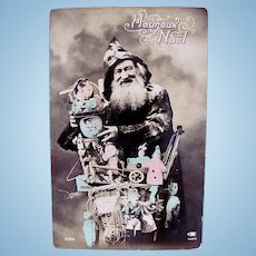 French Tinted Real Photo Postcard, Santa with Dolls and Toys, Circa 1910s