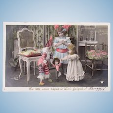 French Tinted Real Photo Postcard, Polichinelle, Bébé, and Boys Dolls Dated 1906