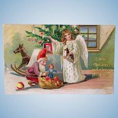 Embossed Gilt Postcard, Angel, Elf, Dolls and Toys, Postmarked 1905