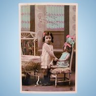 French Tinted Real Photo Postcard, Girl Holding Doll's Hand, Happy Anniversary, Circa 1910s