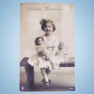 Dutch Real Photo Postcard, Little Girl and 2 Dolls, Happy New Year, Circa 1930s