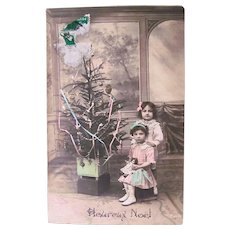Hand Tinted French Real Photo Postcard, Boy, Girl, Doll and Christmas Tree, Circa 1910s