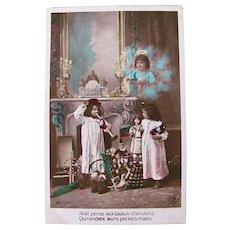 French Tinted Real Photo Postcard, Children, Cherub, Dolls and Toys, Christmas Morning ca. 1910