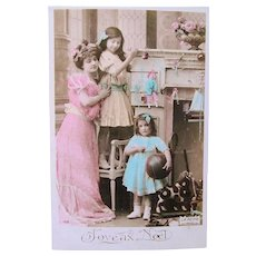 Tinted French Real Photo Postcard, Mother and Daughters, Dolls, Toys, Merry Christmas, Postmarked 1910