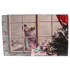 German Tinted Real Photo Postcard, Girl and Doll at a Window, Christmas Circa 1910s