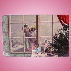 German Tinted Real Photo Postcard, Girl and Doll at a Window, Christmas Circa 1910s