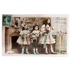 Tinted French Real Photo Postcard, Children, Dolls and Toys, New Year's Circa 1910s