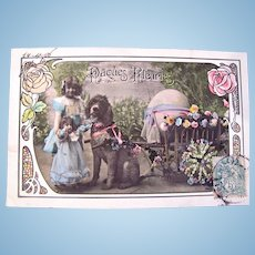 French Tinted Real Photo Postcard, Easter Flowers, Girl with Doll, Poodle, Flower Cart and Egg, Dated 1906