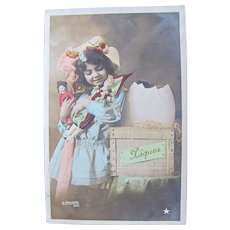 Easter, French Tinted Real Photo Postcard, Little Girl, Dolls and Egg in Crate, Postmarked 1909