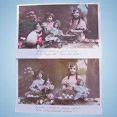 Tinted French Real Photo Postcards, Set of 2, Girl and Boy with Dolls and Easter Eggs, Circa 1909