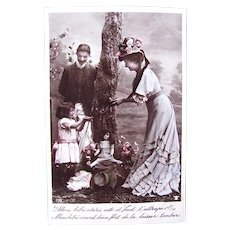 French Tinted Real Photo Postcard, Family Picnic, Mother, Father, Girl and Doll, Postmarked 1908