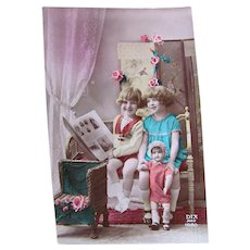 French Tinted Real Photo Postcard #4, Children with Doll, Circa 1920s