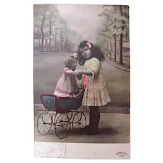 Tinted French Real Photo Postcard, Girl, Doll and Pram, Walking My Baby, 1910s