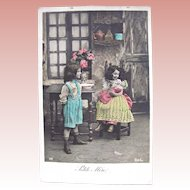 French Tinted Real Photo Postcard, Little Mother, Boy, Girl and Baby Doll, Circa 1910s