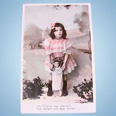 French Doll and Girl, Tinted Real Photo Postcard, First Steps, Dated 1907