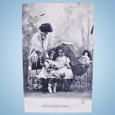 Little Mothers #2, Dolls and Girls in the Park, French Real Photo Postcard Postmarked 1906