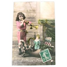 French Tinted Real Photo Postcard, Boy, Horn, Dolls and Toys, Christmas, Circa 1910s