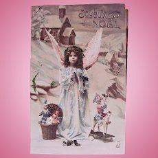 French Angel, Dolls and Mistletoe, Tinted Real Photo Christmas Postcard Circa 1910s
