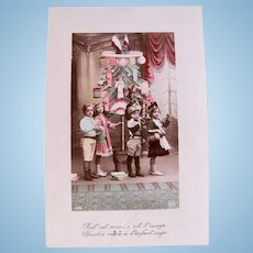 French Christmas Card, 4 Children, Doll and Toys, Tinted Real Photo Postcard, Circa 1910s