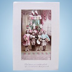 French Christmas, 4 Children, Doll and Toys, Tinted Real Photo Postcard, Circa 1910s