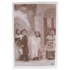 Tinted French Real Photo Postcard, The Doll's Christening, 4 Children, Doll, circa 1910s