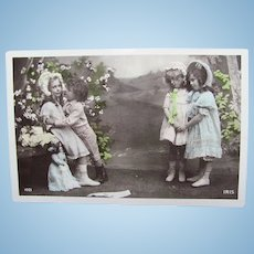 French Tinted Real Photo Postcard, Girls, Boy and Dolls, Postmarked 1908