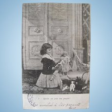French Real Photo Postcard, Girl, Dolls and Toys, Postmarked 1903