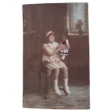 French Tinted Real Photo Postcard, Seated Girl Holding Doll #4, Circa 1910s
