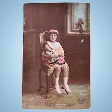 Tinted French Real Photo Postcard #2, Seated Girl Holding Doll and Roses, Circa 1910s