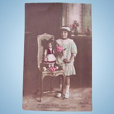French Tinted Real Photo Postcard #1, Doll on Chair, Little Girl and Roses, Circa 1910s