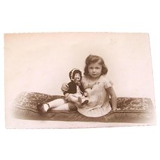 French Real Photo Postcard, Little Girl With AM Baby Doll, Unused Circa 1930s