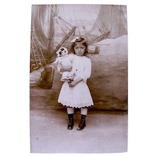 French Real Photo Postcard, Little Girl Holding Bisque Doll, Seaside Scene, Circa 1910s