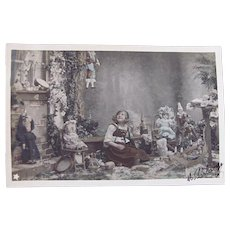 Tinted French Real Photo Postcard, Seated Girl, Dolls and Toys #2, Postmarked 1903