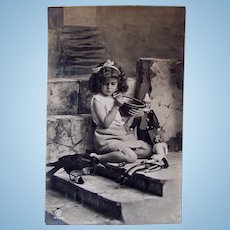 French Real Photo Postcard, Little Girl, 3 Dolls and Raven #1, Postmarked 1909