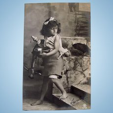 French Real Photo Postcard, Pretty Little Girl, Dolls and Raven #2, Postmarked 1909