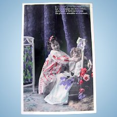 Tinted French Real Photo Postcard, Girl, Doll, Flowers, Postmarked 1907