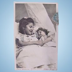 French Tinted Real Photo Postcard, Little Girl, Big Doll, Postmarked 1904