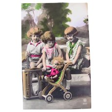 French Tinted Real Photo Postcard, 3 Children, Doll, Stroller, Circa 1920s