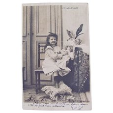 French Real Photo Postcard, Little Girl With Doll, Postmarked 1905