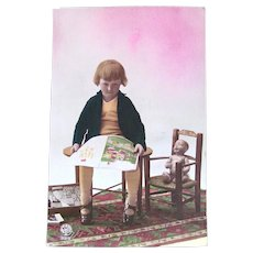 Tinted French Real Photo Postcard, Doll, Child and Book, Circa 1920s