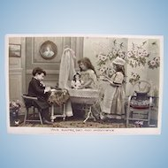 French Tinted Real Photo Postcard, 3 Children and Doll, Circa 1910s