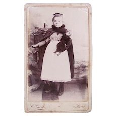 French Cabinet Card Photograph, Girl in Cape and Cap, Holding Doll, Circa 1880s