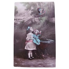 Tinted French Real Photo Postcard, Girl, Doll, Buggy and Bird, Ca. 1910s