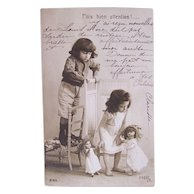 French Real Photo Postcard, Boy, Girl and 2 Dolls, Postmarked 1905