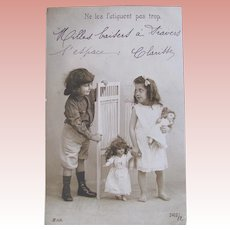 French Real Photo Postcard, Boy, Girl and Dolls, Bedtime, Postmarked 1905