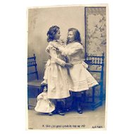 2 Girls and Doll, French Real Photo Postcard, Circa 1890s