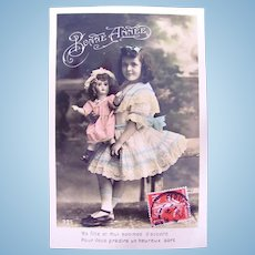 French Tinted Real Photo Postcard, Doll and Girl, Circa 1910s
