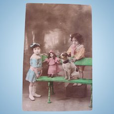 Tinted French Real Photo Postcard, Children, Dog and Doll, Dated 1908