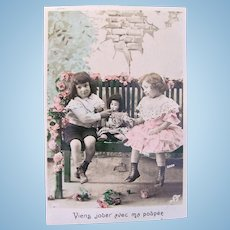 Tinted French Real Photo Postcard, 2 Children and Doll, Circa 1910s
